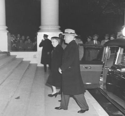 Harry and Bess Truman on the White House North Portico on the night they returned to live in the renovated mansion. (National Archives)