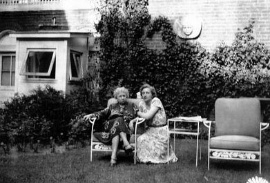 Bess Truman relaxing in the Blair House garden with her daughter. (HSTL)